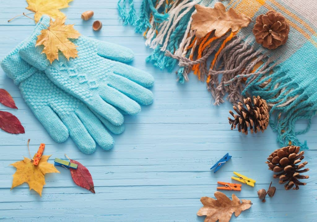 Autumn colours and fall leaves with cosy knitted gloves. Autumn and halloween knitting patterns.